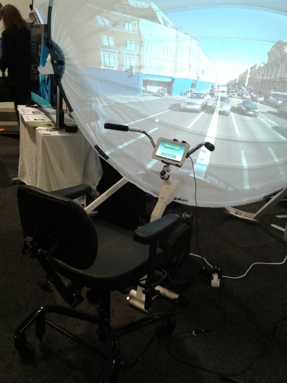 A seated bike with display encourages exercise among the elderly. The sturdy seat ensures that no one falls off the bike. The curved screen tricks the rider's mind into believing that she is riding her bike outside.