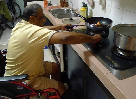 A video still showing a senior cooking. An adjustable height chair could make cooking easier. (Photo: DesignSingapore)